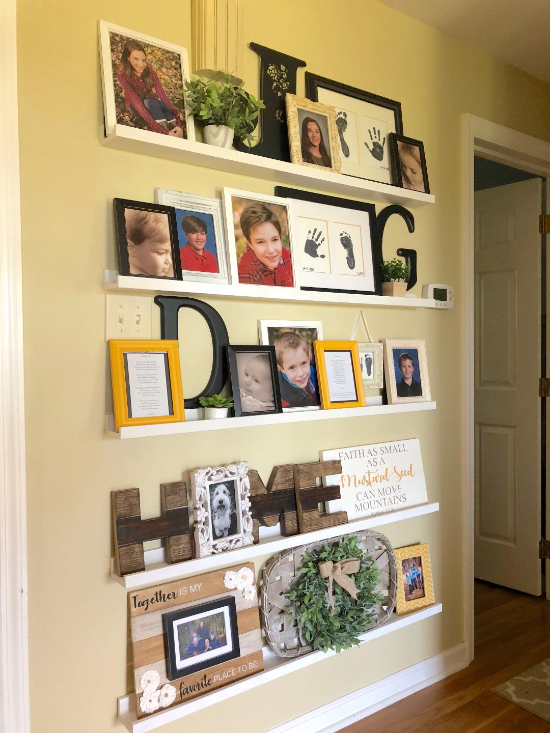a hallway that incorporates a gallery wall with family photos