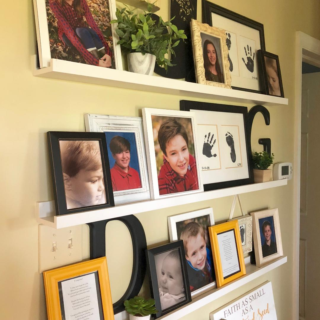 close up of a gallery wall with family photos