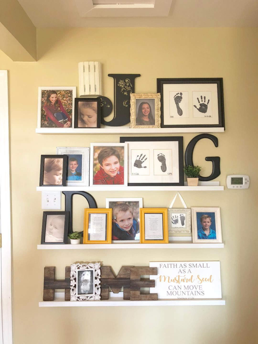 close up of a gallery wall in an entryway