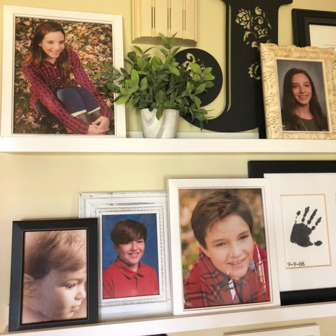 close up of photos shown on a gallery wall