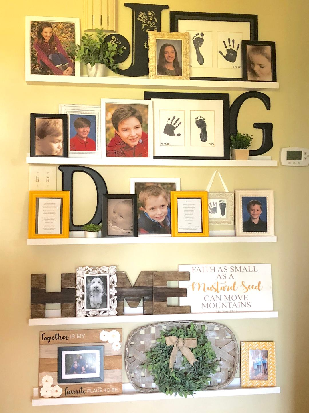 a full height gallery wall using family photos and home decor