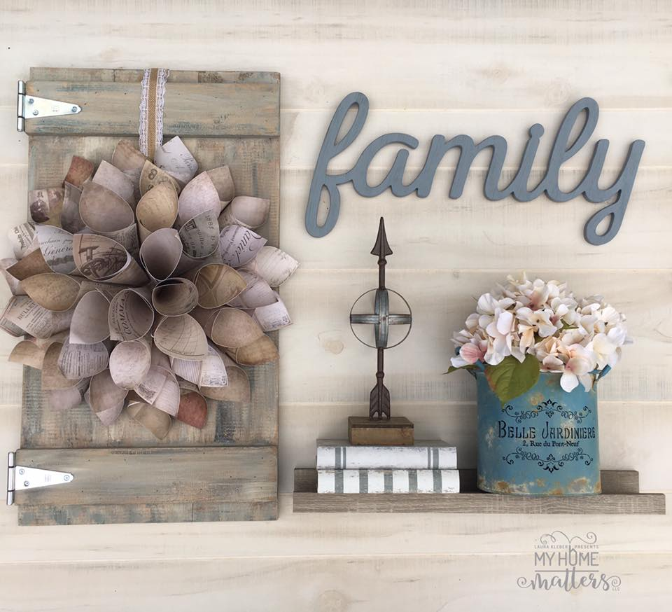 to show a paper dahlia wreath on a barn door in a wall collage