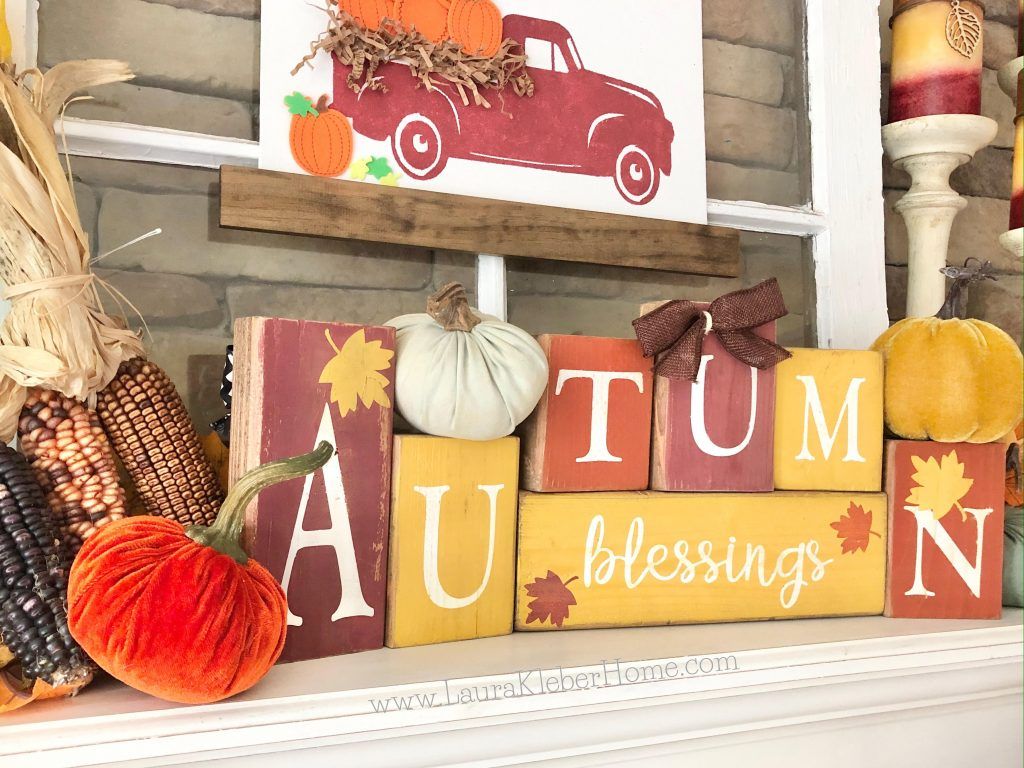 Accessories to decorate a Fall mantel with (letter blocks, dried corn, pumpkins)
