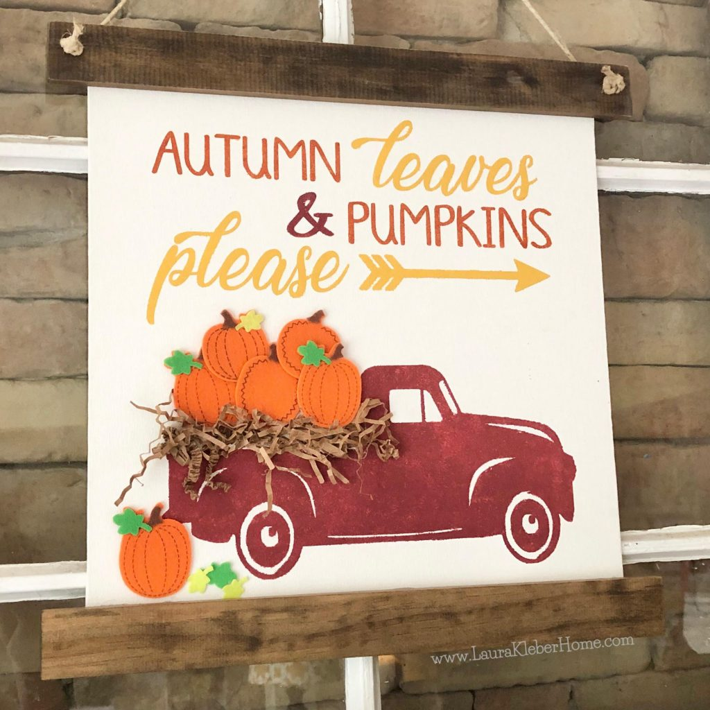 Using a fall banner sign to show layers when decorating a fall mantel