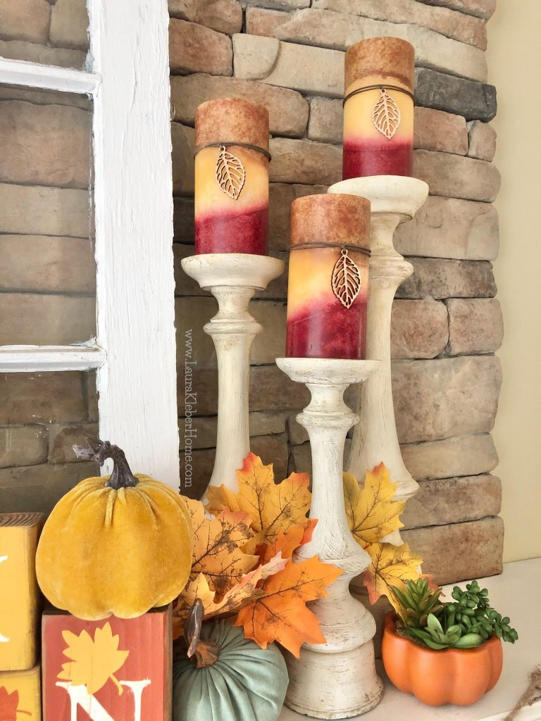 Using candles when decorating a Fall mantel