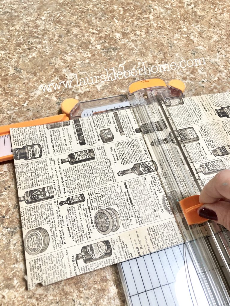 to show how to cut the scrapbook paper for the paper dahlia wreath into squares