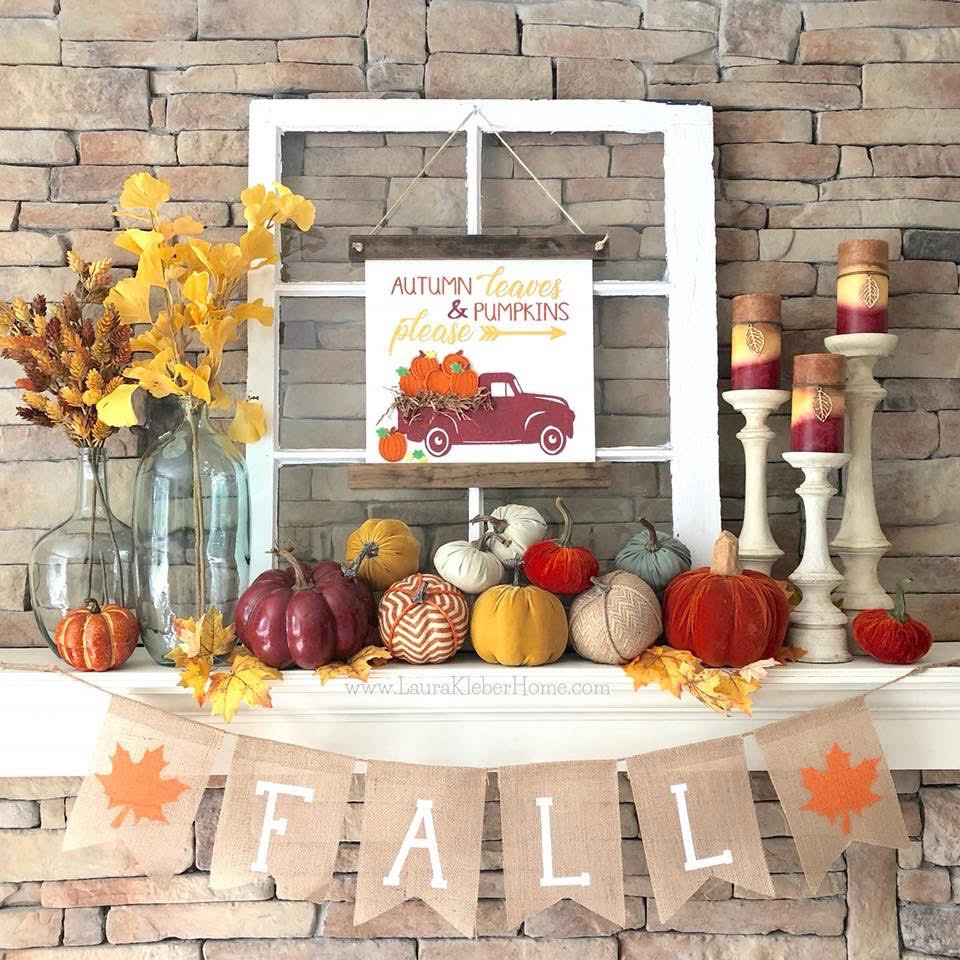 Fall decorated mantel with pumpkins, fall stems, fall candles and fall banner