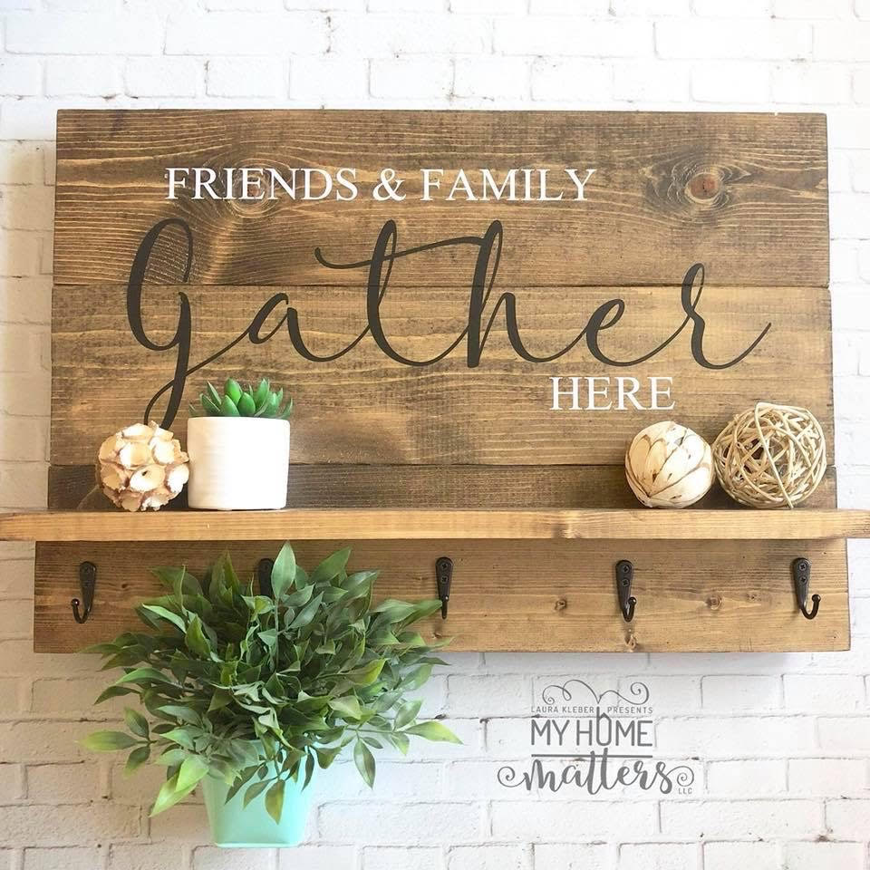 wooden planked farmhouse style sign with saying that can be used on a wall to hang coats, decorations and more in a mud room or entryway