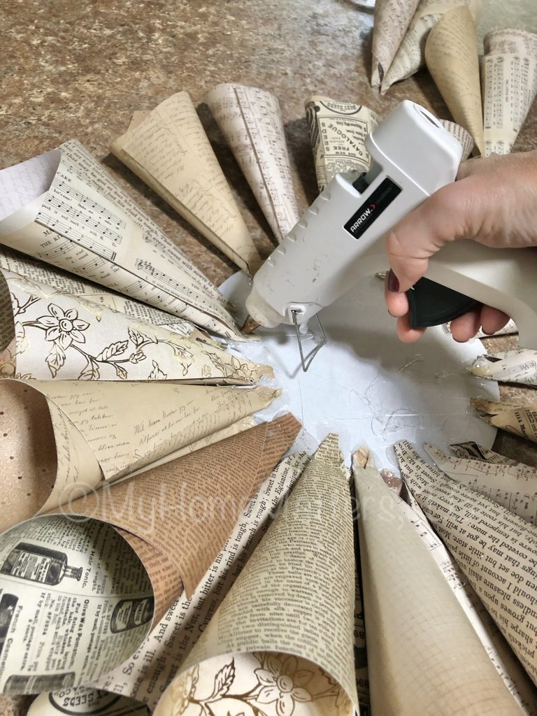 to show how to glue on the paper cones to make a paper dahlia wreath