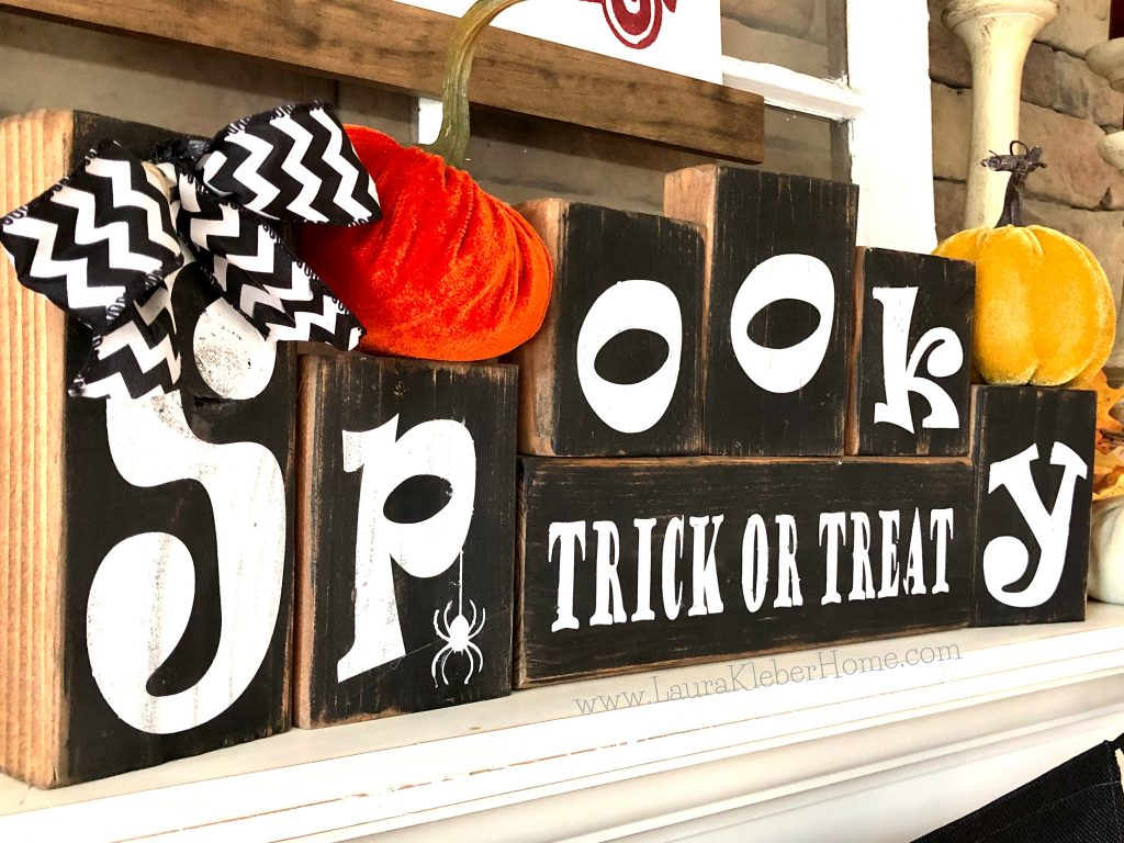 Halloween letter blocks shown on a Fall mantel with pumpkins