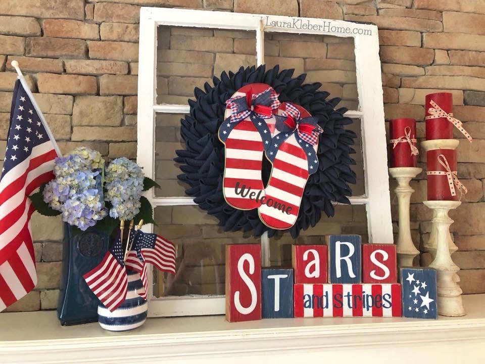 patriotic fourth of july mantel decorated with red, white and blue using an old window