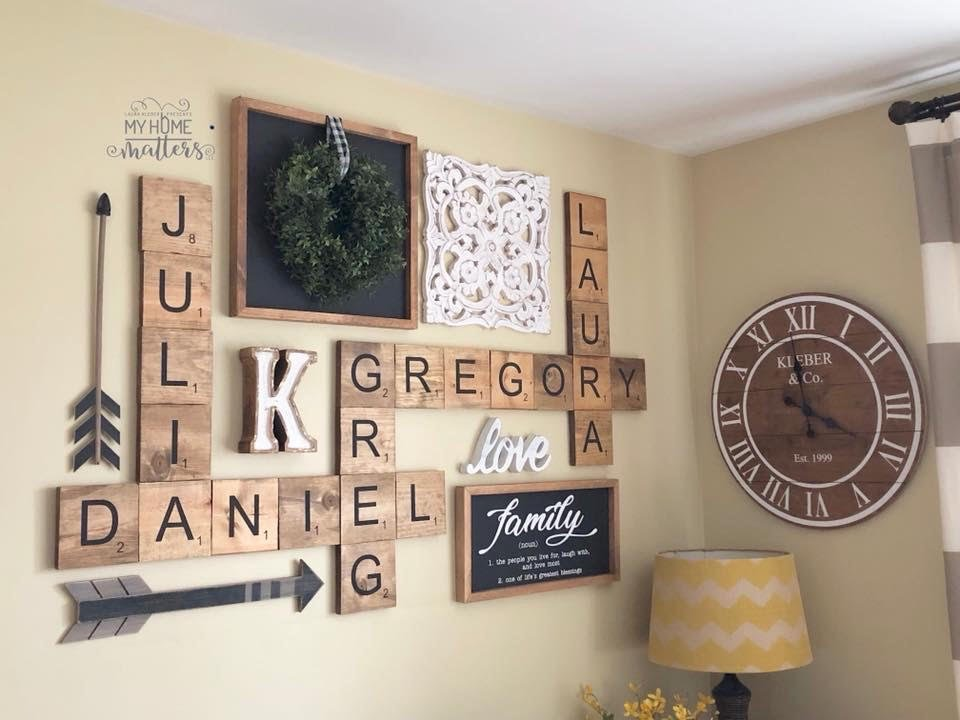 scrabble wall tiles, wall collage using family names, farmhouse style signs and farmhouse decorations hung on the wall in living room