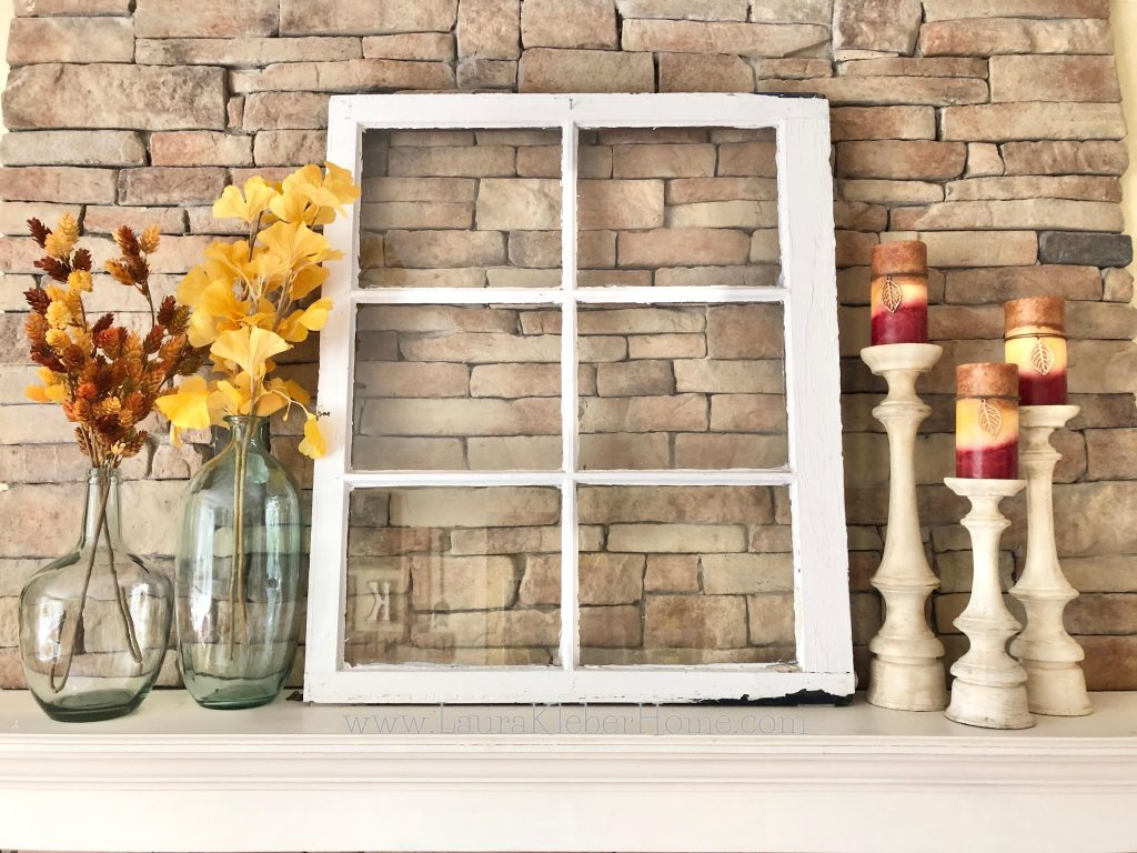 Using Fall decor on a mantel in a way that shows balance