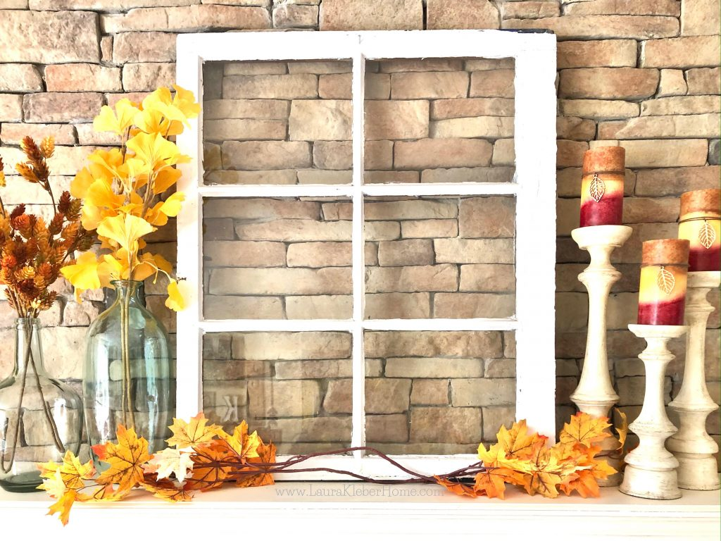 Adding layers when decorating a Fall mantel (things such as leaves, stems, candles, vases, an old window)