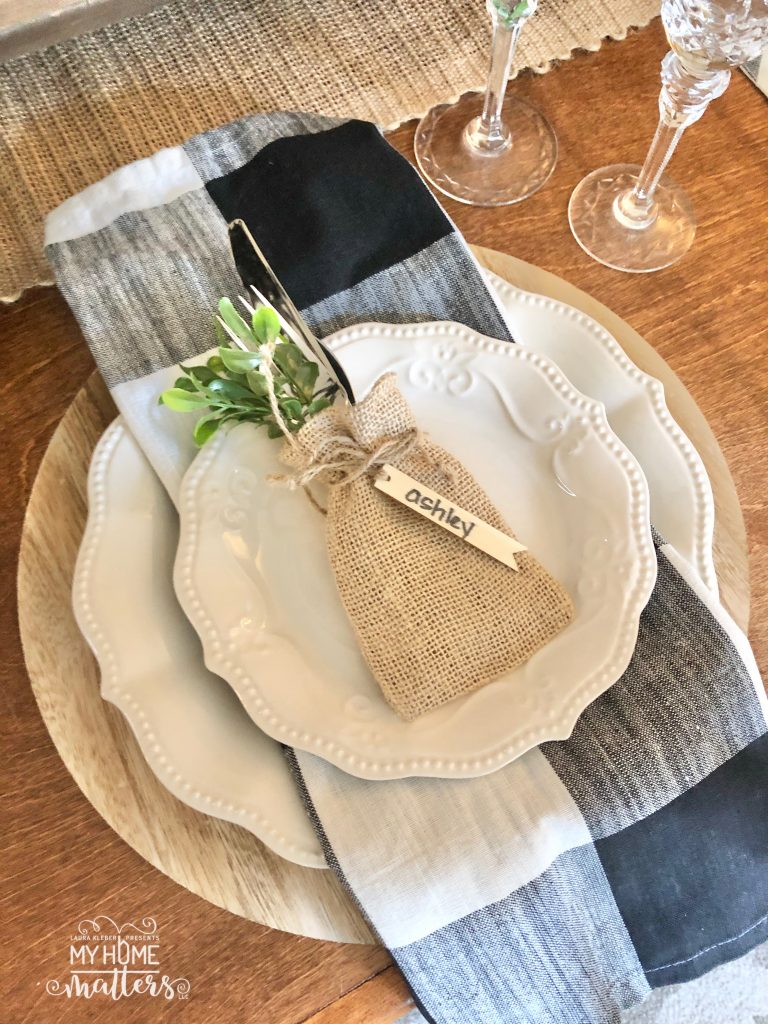 to show how to use buffalo check napkins to decorate a dining room table