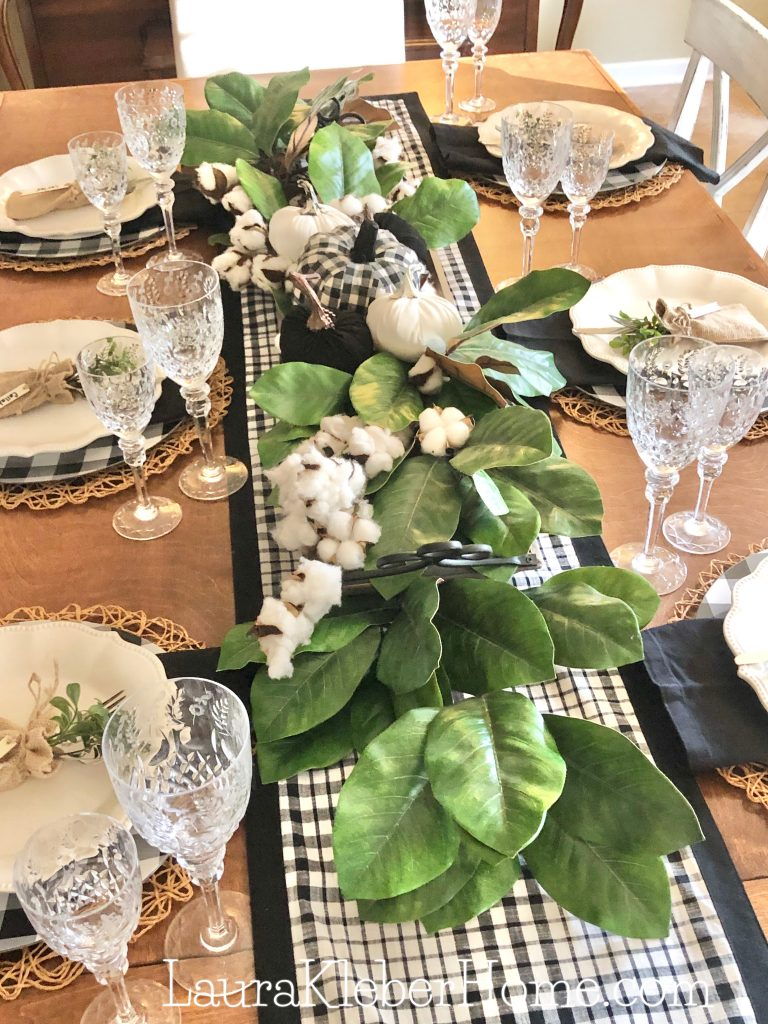 to show a table decorated with buffalo check decor