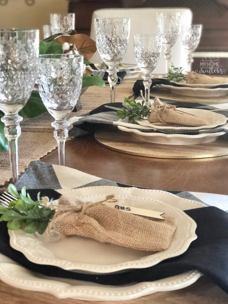 to show a dining table decorated with buffalo check napkins and place mats