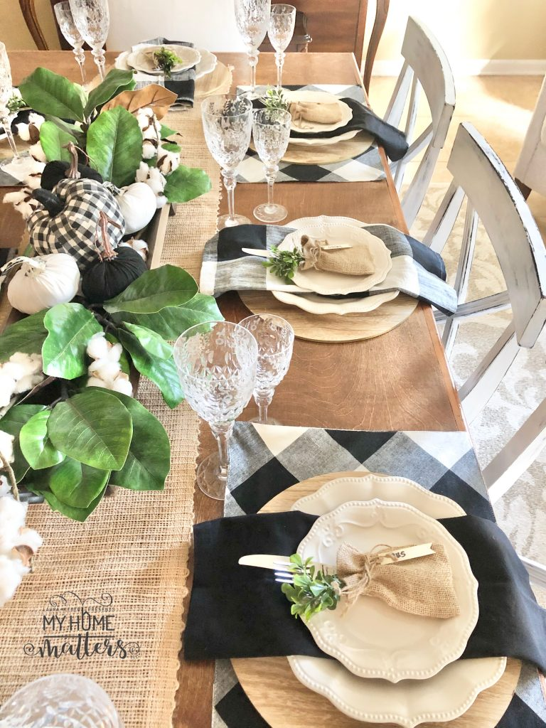 to show how to use buffalo check to decorate a dining table