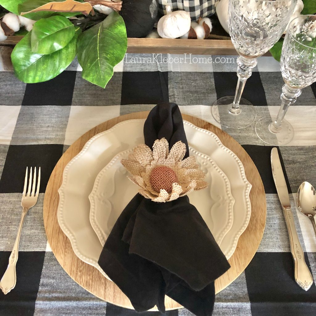 to show a dining table decorated with buffalo check