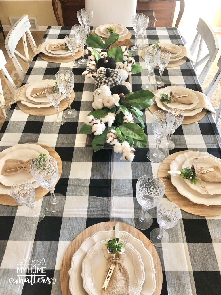 to show how to decorate a dining table using buffalo check