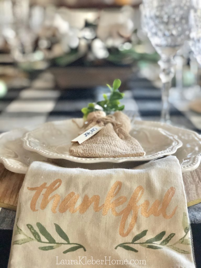 to show a dining room place setting on a buffalo check table cloth