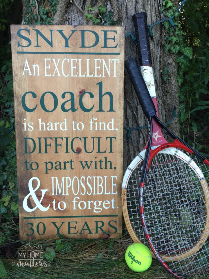 rectangular wooden sign personalized with a saying for a coach
