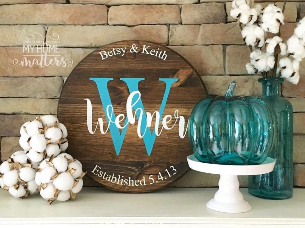 round wooden sign personalized with last name and wedding date