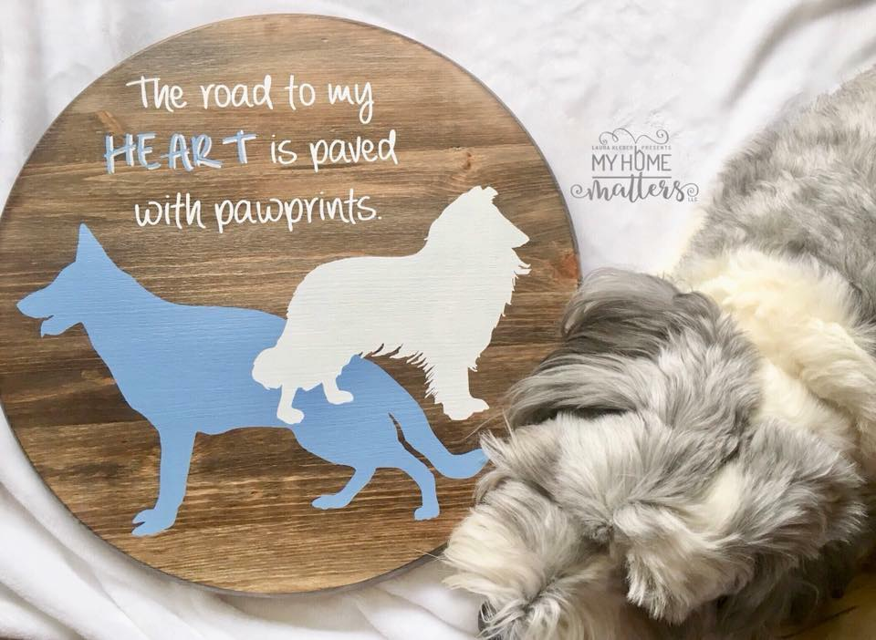 round wooden sign personalized with dog silhouettes