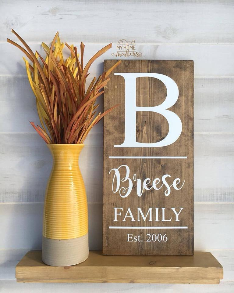 rectangular wooden sign personalized with last name and wedding date