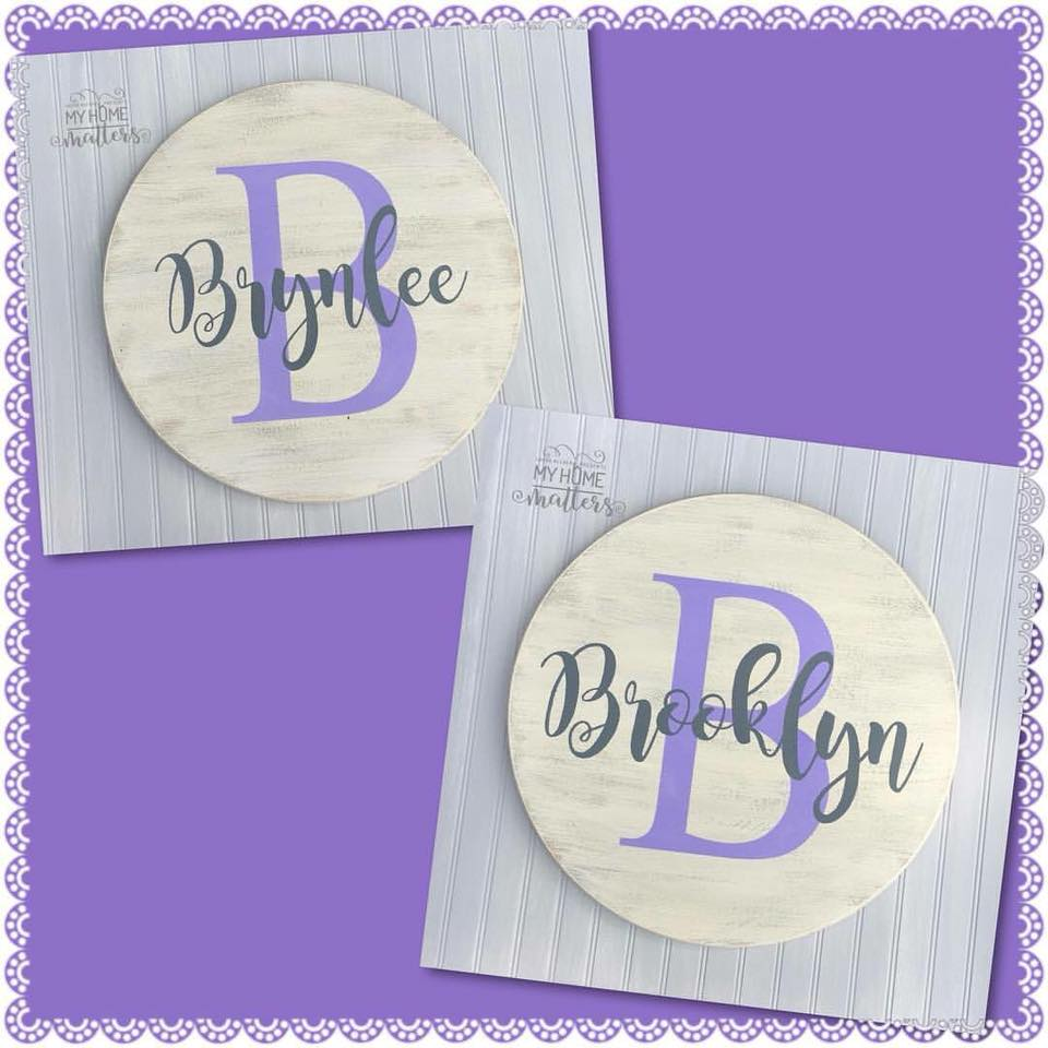 round wooden signs personalized with girls' names and monogram