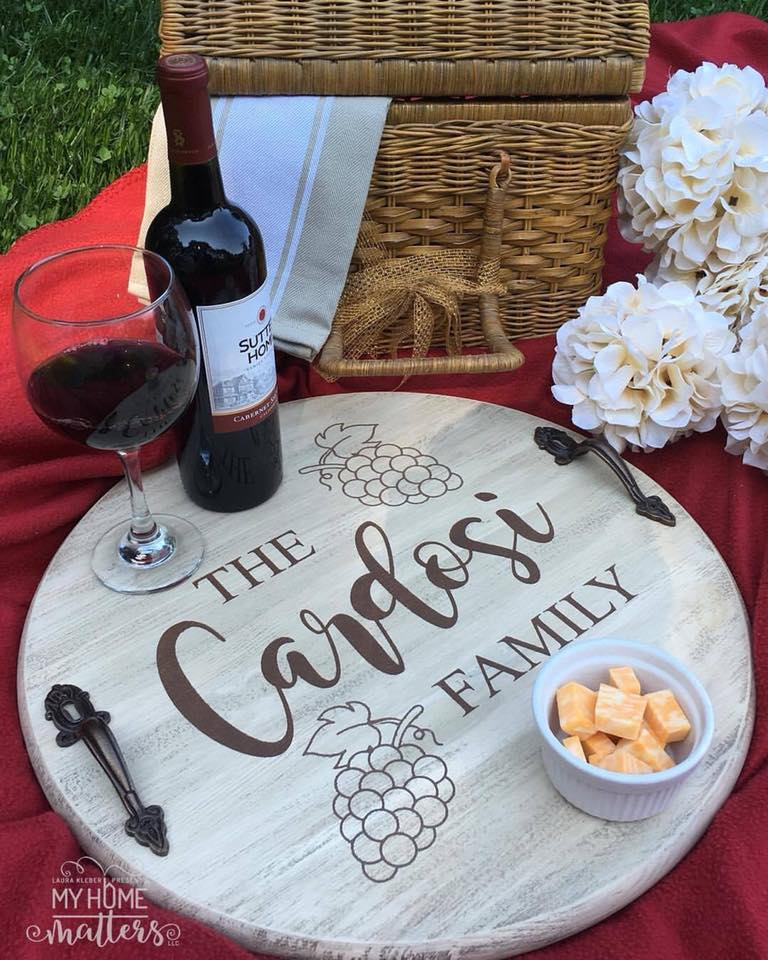 round wooden tray personalized with last name and a wine theme