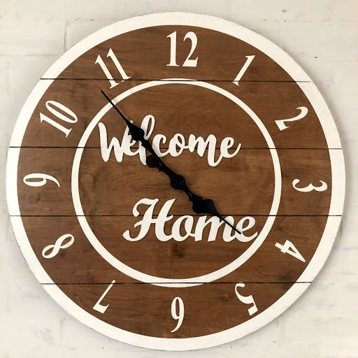 round wooden sign personalized with WELCOME HOME