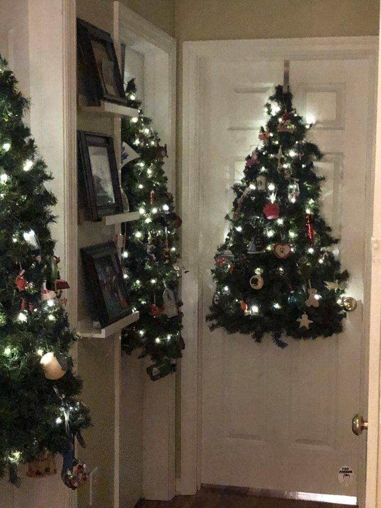 kids lighted Christmas Trees that hang on bedroom doors