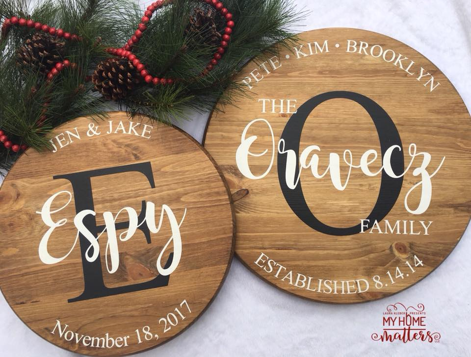 two round wooden signs personalized with family names and wedding dates