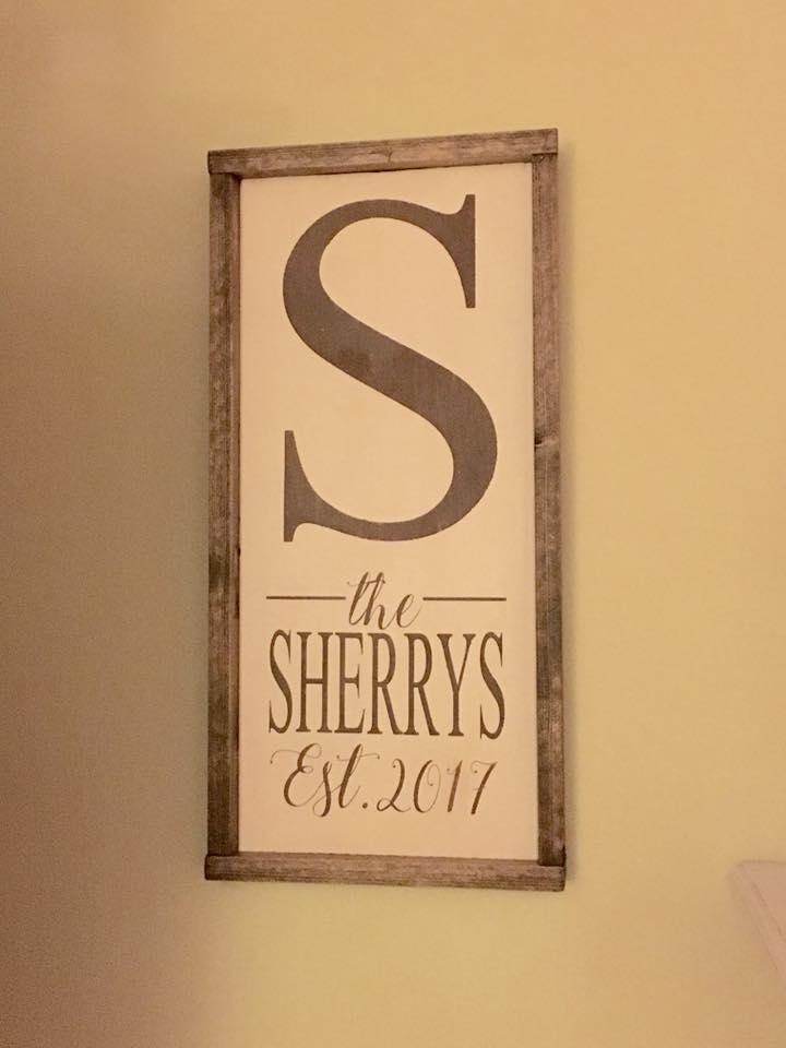 framed wooden sign personalized with last name