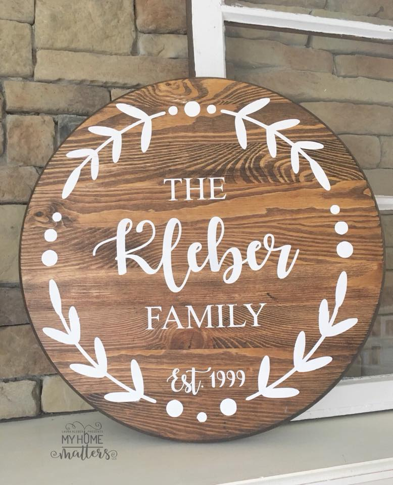 round wooden sign personalized with last name