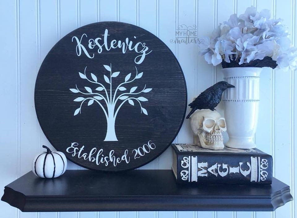 round wooden sign personalized with family name and family tree