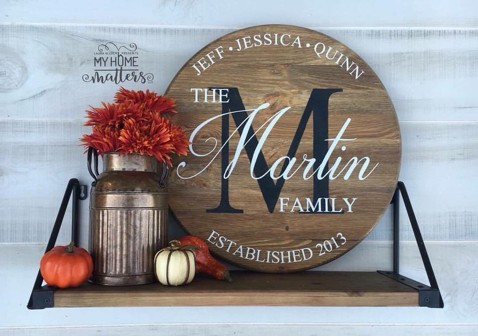 round wooden sign personalized with family names