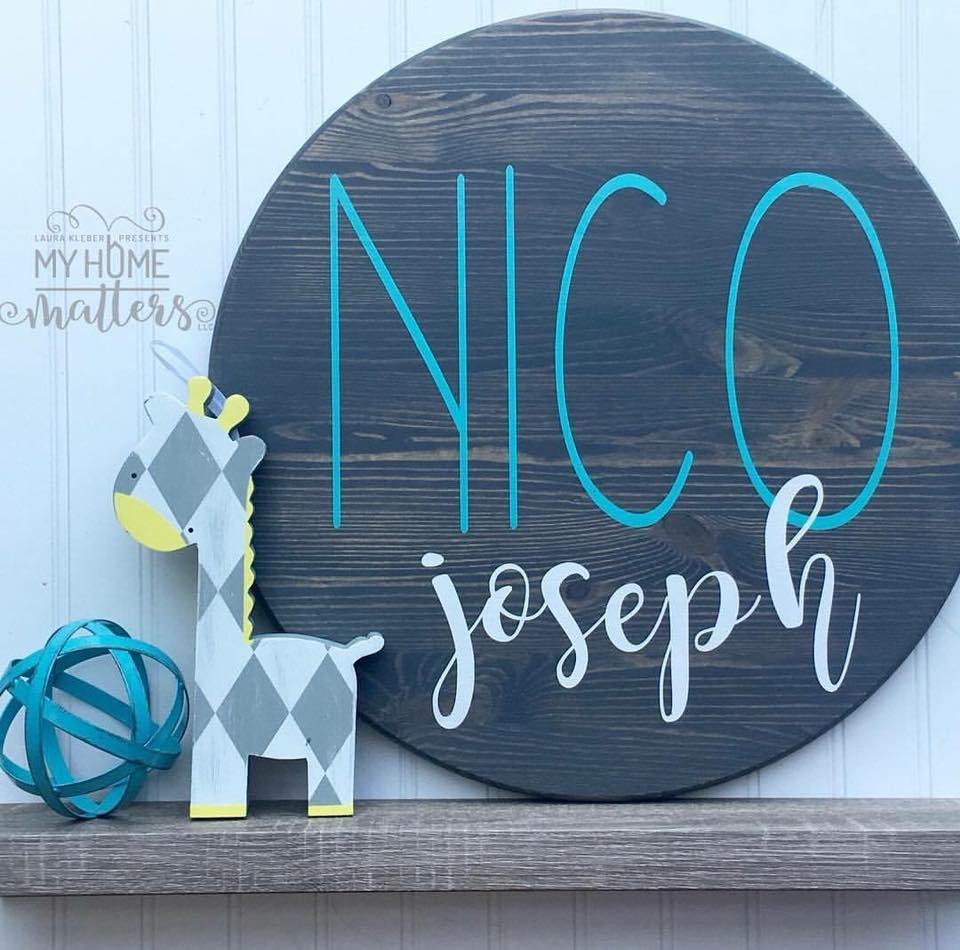 round wooden sign personalized with child's name
