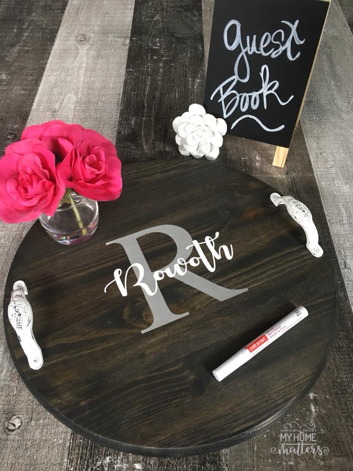 round wooden tray personalized with last name as wedding guest book