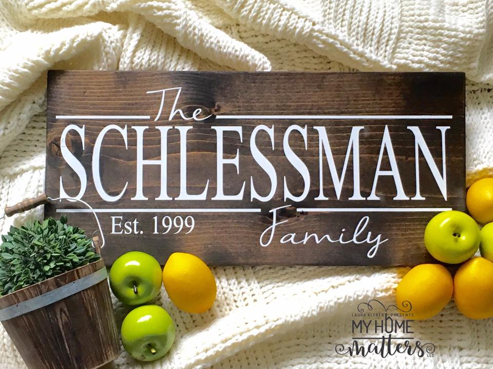 Wooden sign personalized with last name and established date