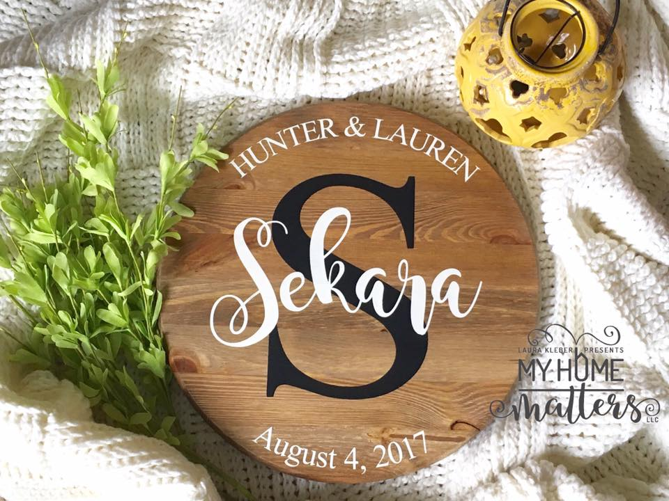 round sign personalized with last name and wedding date