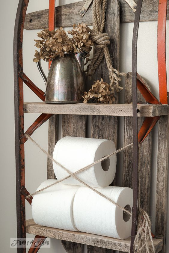 an old sled converted into a shelf for bathroom storage