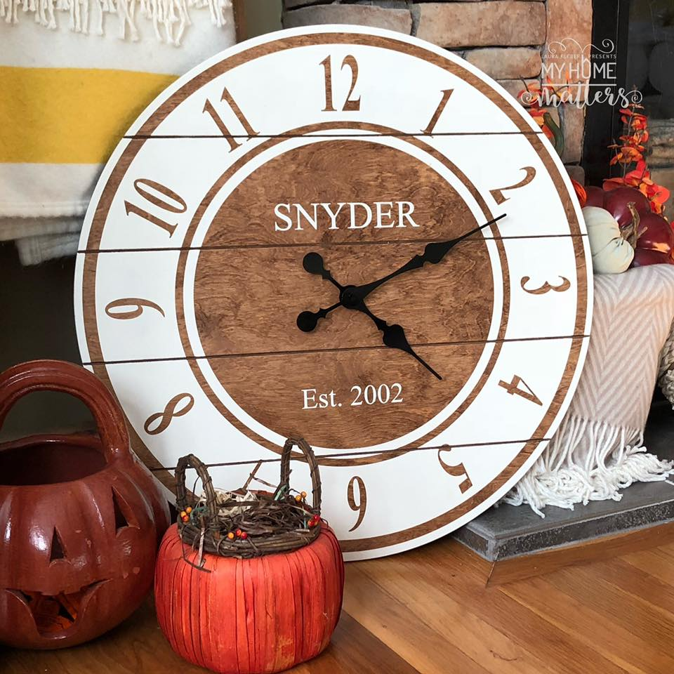 round wooden clock personalized with last name and wedding date
