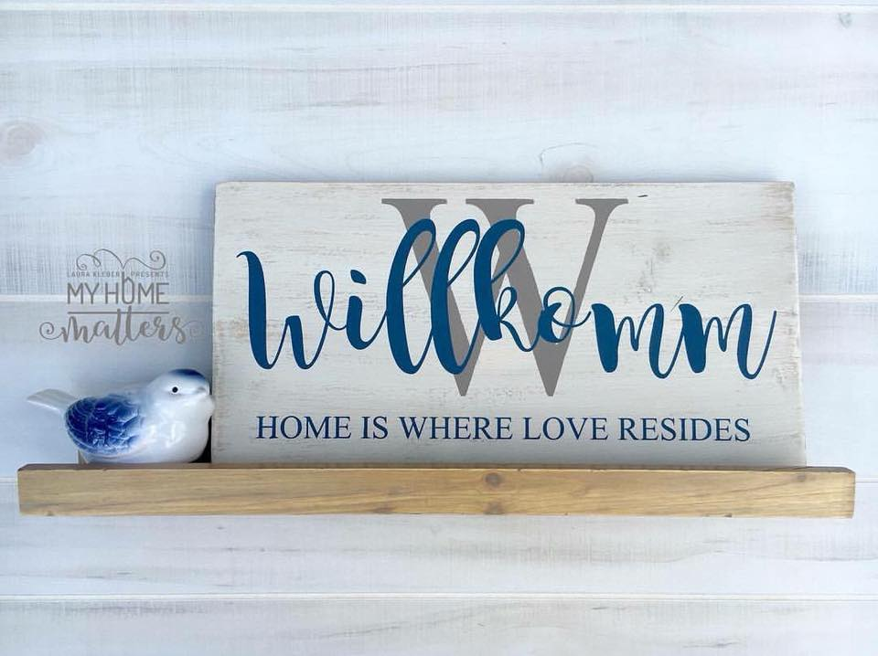 rectangular wooden sign personalized with last name and saying