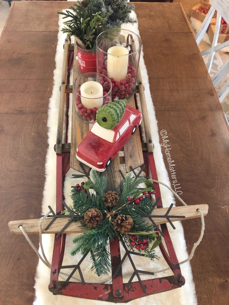 old sled on top of a dining table used as a decorative centerpiece