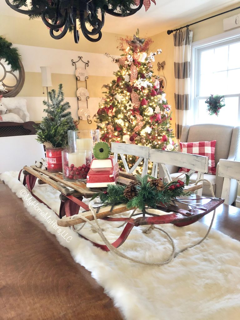 an old sled used as a decorative centerpiece on top of a dining table