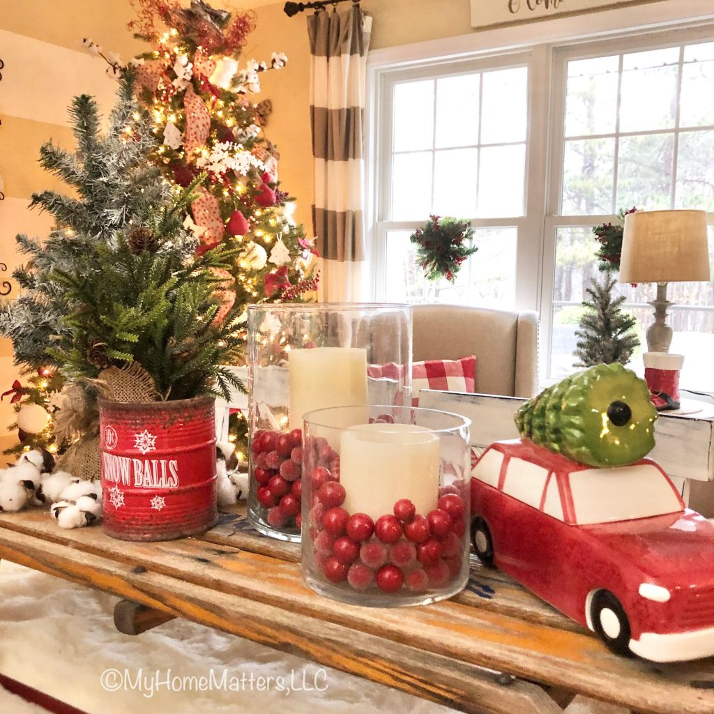 an old sled used on a dining table as a Christmas centerpiece