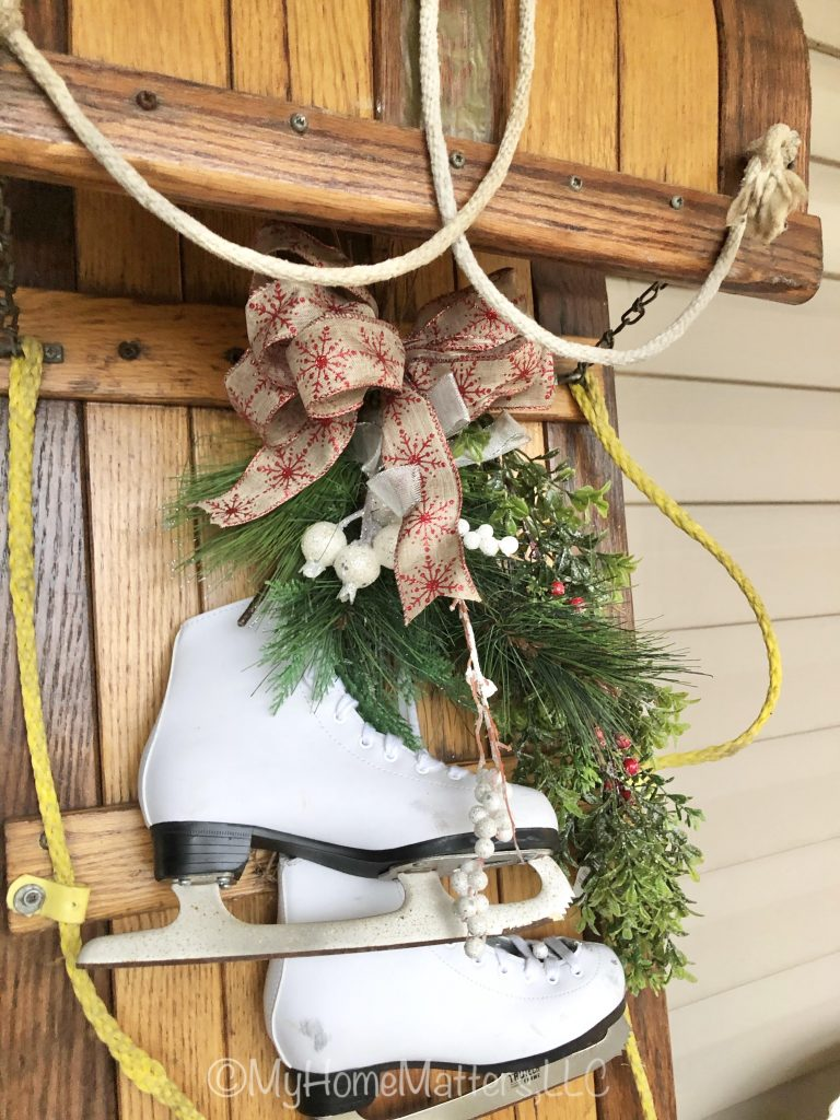 toboggan close up of skates hanging from it for Christmas decor