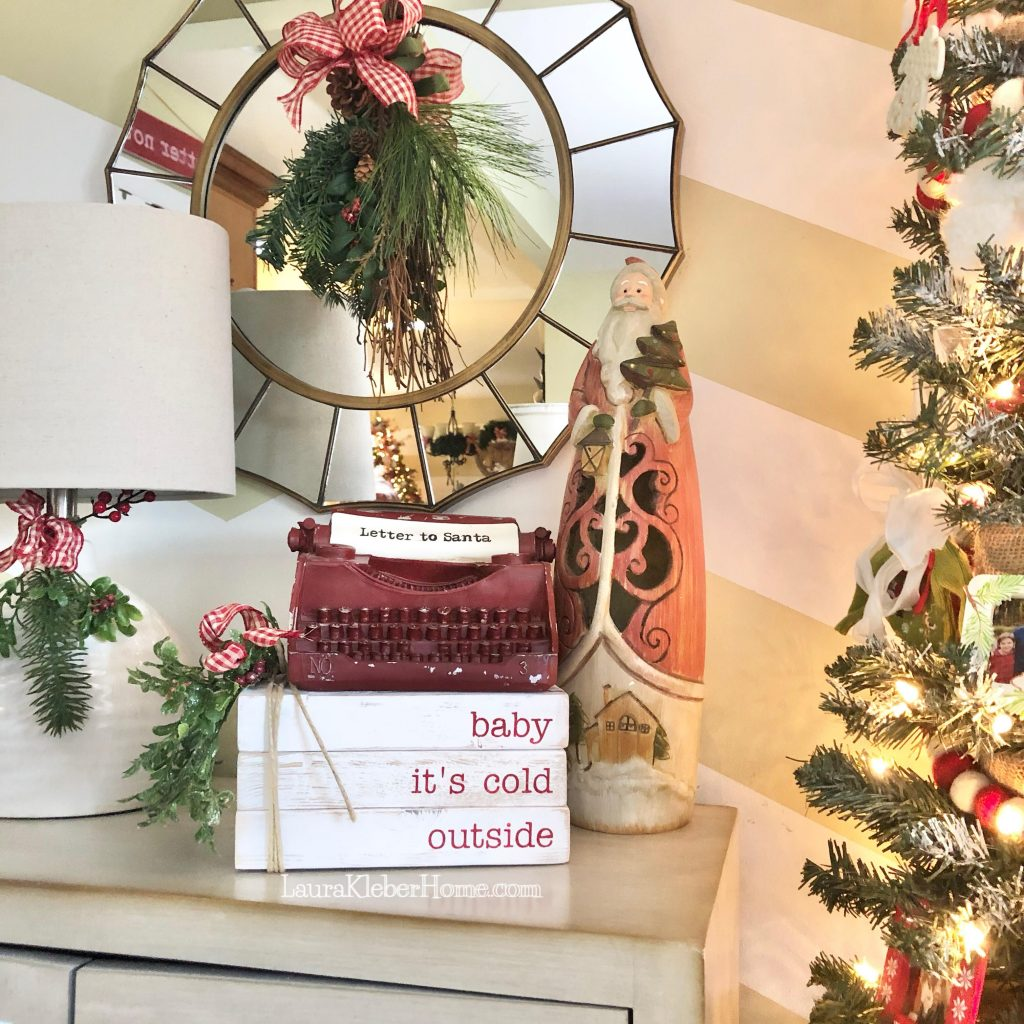 """a decorative typewriter that says """"Letter to Santa"""" sitting on top of some decorative wooden books"""